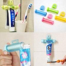 Creative 2pcs/set Rolling Squeezer Toothpaste Dispenser Tube Partner Sucker Hanging Holder Color Random,Free Shipping