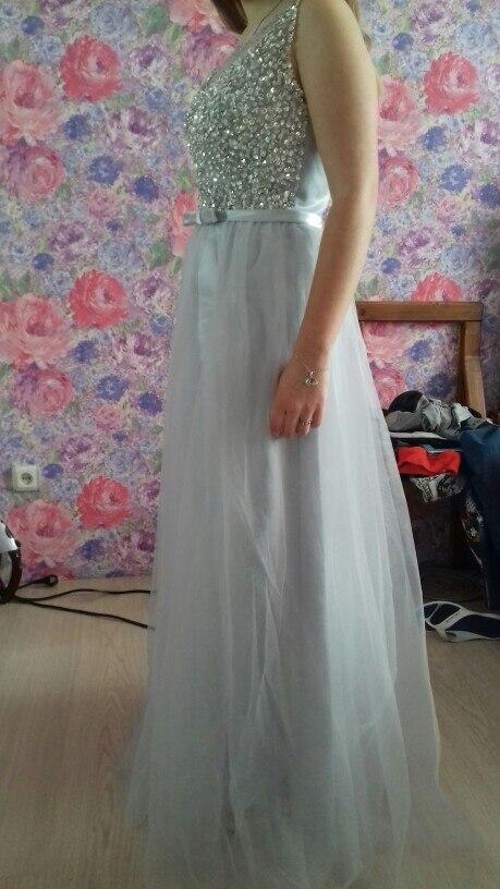 Замечательное платье! Дочь в восторге. На российский 42 размер заказала 4, подошло идеально.На рост 162 длинна отличная (с каблуком). Доставка до квартиры!