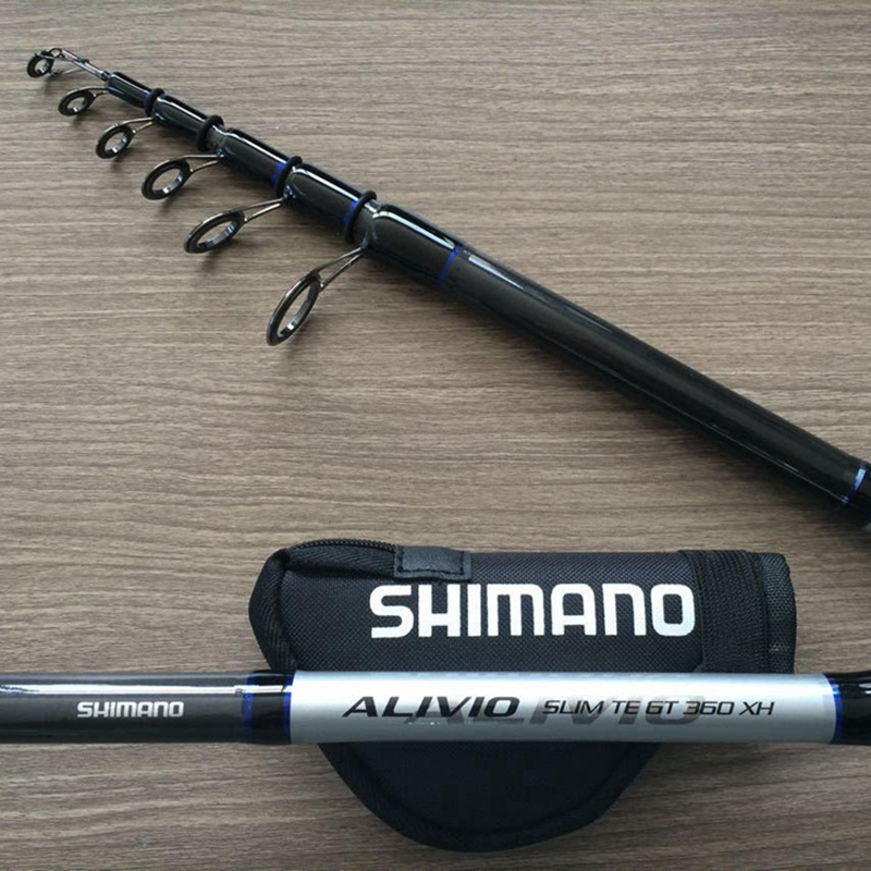 Carbon telescopic fishing rod m h xh power surf spinning for Big fishing pole