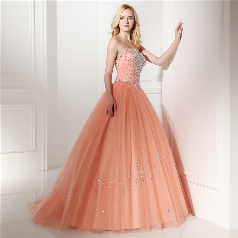 Real Models Peach Ball Gown Prom Dresses Evening Party Women Dress With Rhinestone  Beadings Sequins Vestidos De Quince Anos 2019-in Prom Dresses from ... f0fdde1e1893