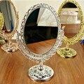 Estilo Antiguo europeo de Bronce Giratoria de Escritorio Espejo de aumento con Flor En Relieve Elipse Espejo de Maquillaje espejo portátil