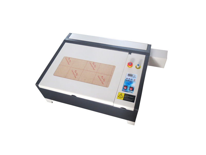 Cheap price  LY 4040M CO2 Laser Engraving mini stamp laser engraving machine 3040 for rubber/ cloth/wood mini portable co2 laser engraving machine price for metal paper wood acrylic