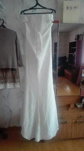"""Ожидали чего угодно, но ожидания не подтвердились и платье пришло просто отличное. Принесли курьером прямо на дом, с курьерской службой договорились о дате. Вообщем, не пожалела что отдала деньги за доставку. Но в самом платье есть несколько изьянов, но они легко поправимы. Первое, на животе много лишней ткани (видимо для тех, у кого живот есть) сам подклад длиннее чем кружево. Немного подвела и сама ткань подклада, оказалась не такой плотной, как на картинке, но и это не беда, нижнее белье не просвечивается. Так же, тот """"язык"""" который под шнуровкой, оказался намного больше и слегка кривоват. А так, в целом, все отлично. Я довольна заказом и все недочеты легко исправляються в ателье."""