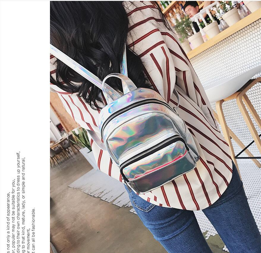 Meloke 2019 New women hologram backpack laser daypacks female silver pu leather holographic bags big girl school bag in Backpacks from Luggage Bags