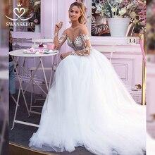Wróżka aplikacje koronkowa suknia ślubna kochanie z długim rękawem iluzja linia księżniczka suknia ślubna szata De Mariee Swanskirt I169