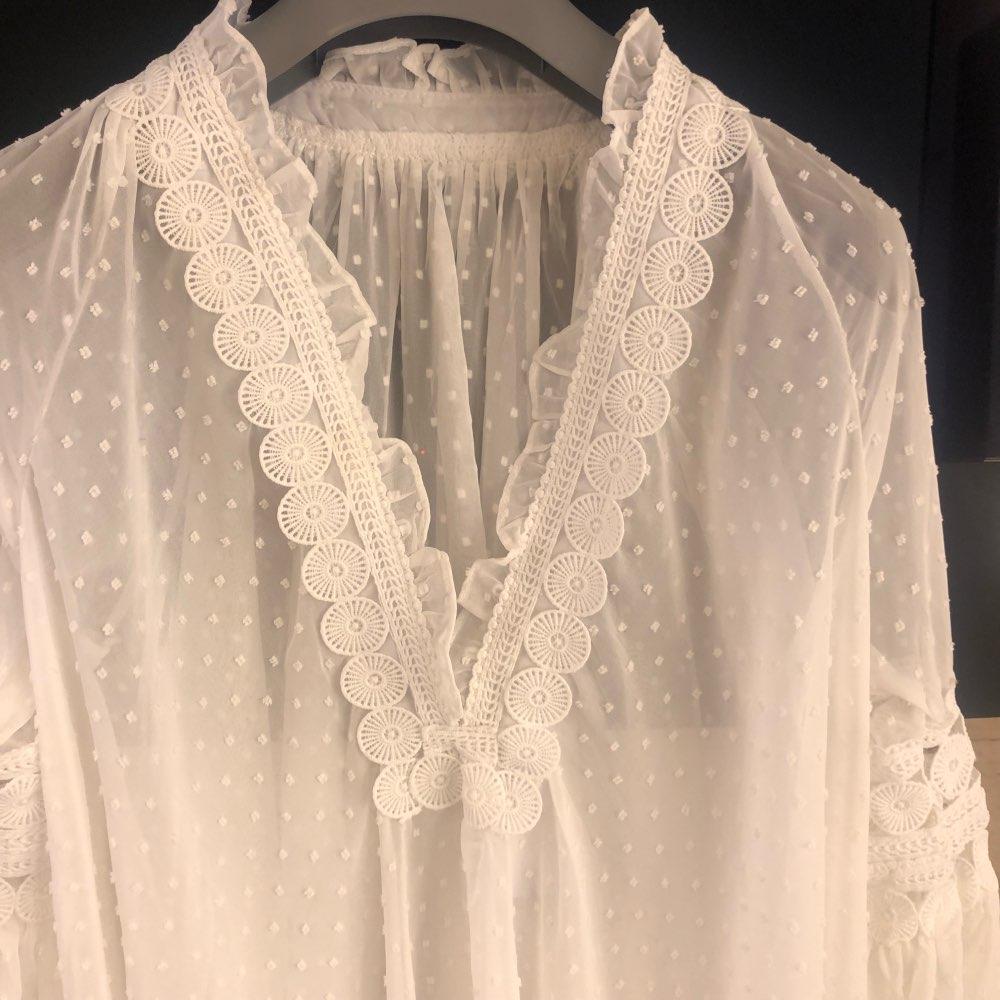 Hollow Out Women Blouse Polka Dot V Neck Bandages Puff Sleeve Asymmetrical Shirt Female Fashion photo review
