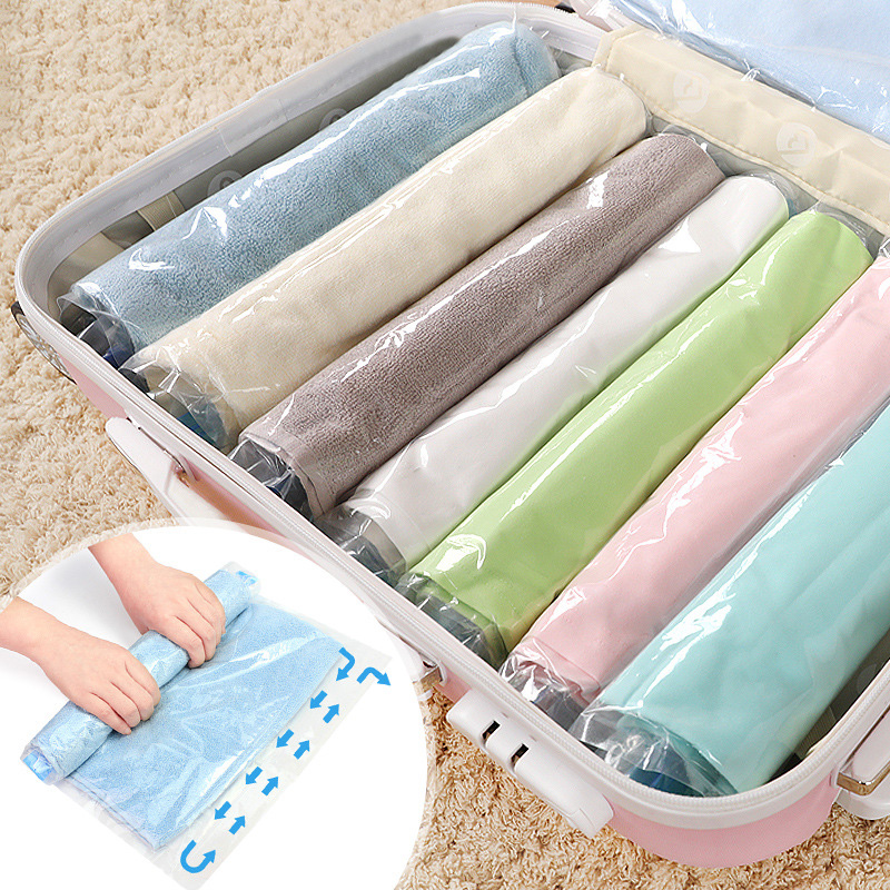 Us 0 82 32 Off Clothes Compression Storage Bags Hand Rolling Clothing Plastic Vacuum Bag Travel E Saver For Luggage 4 Sizes In