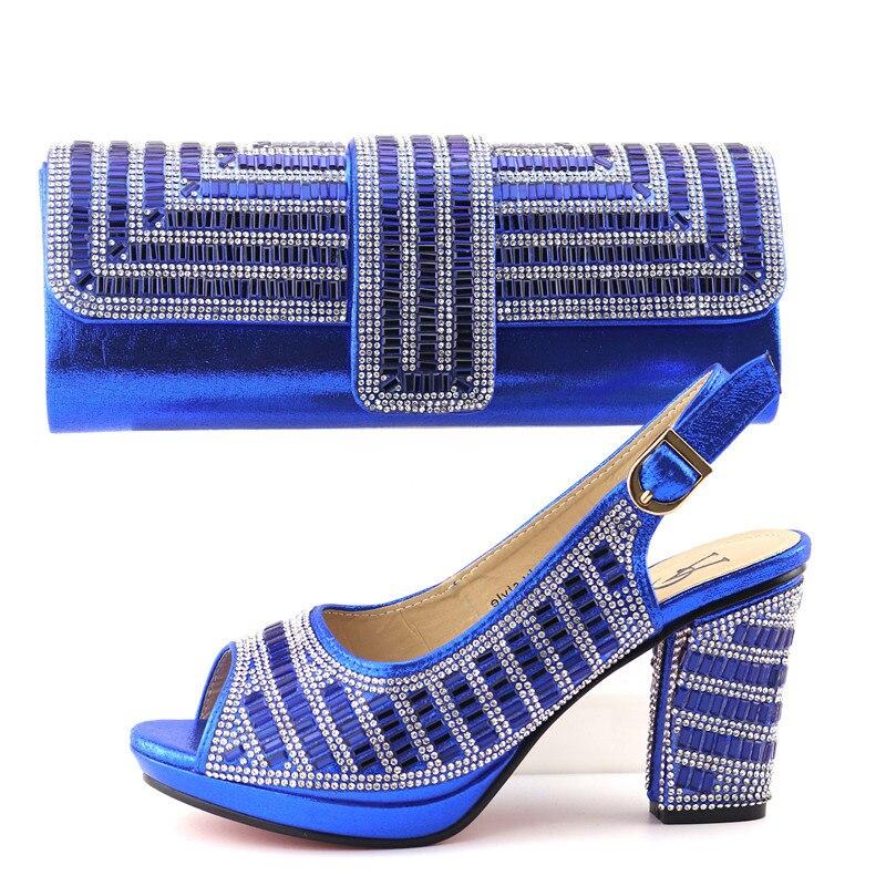 Royal blu scarpe e borsa insieme di corrispondenza per african aso ebi partito scarpe del sandalo della signora con il sacchetto di frizioni libera la nave scarpe borsa SB8342-3Royal blu scarpe e borsa insieme di corrispondenza per african aso ebi partito scarpe del sandalo della signora con il sacchetto di frizioni libera la nave scarpe borsa SB8342-3