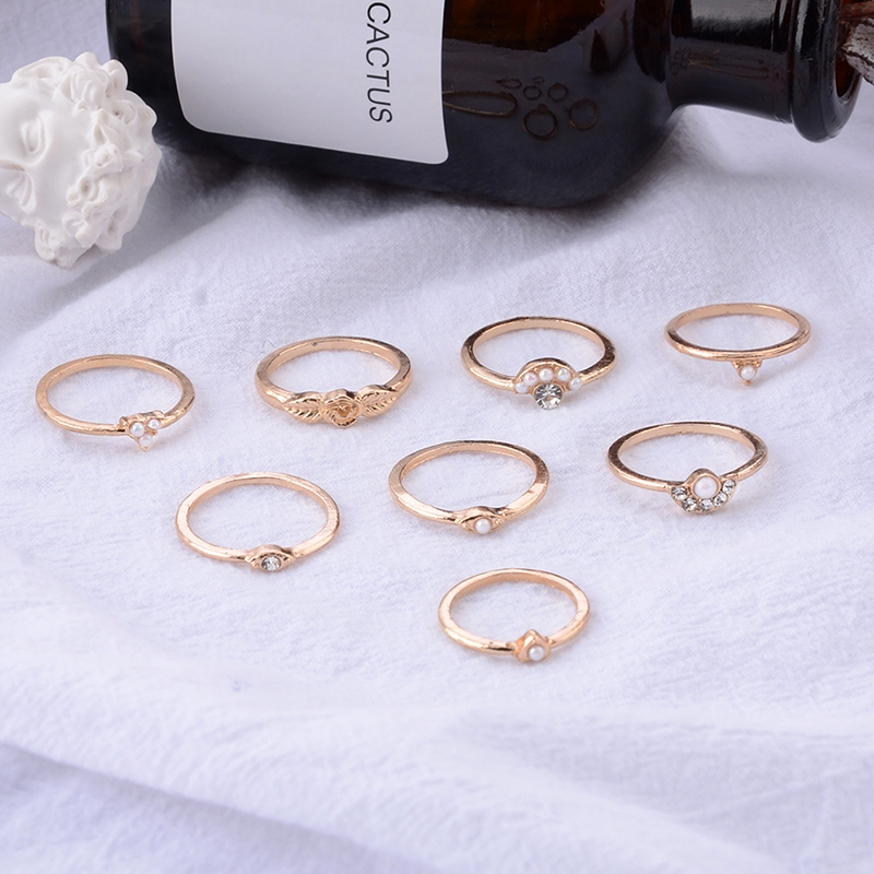 CUTEECO 8Pcs Retro Rose Pearl Charm Joint Finger Rings for Women Gold Color Crystal Star Ring Set Engagement Party Woman Jewelry in Rings from Jewelry Accessories