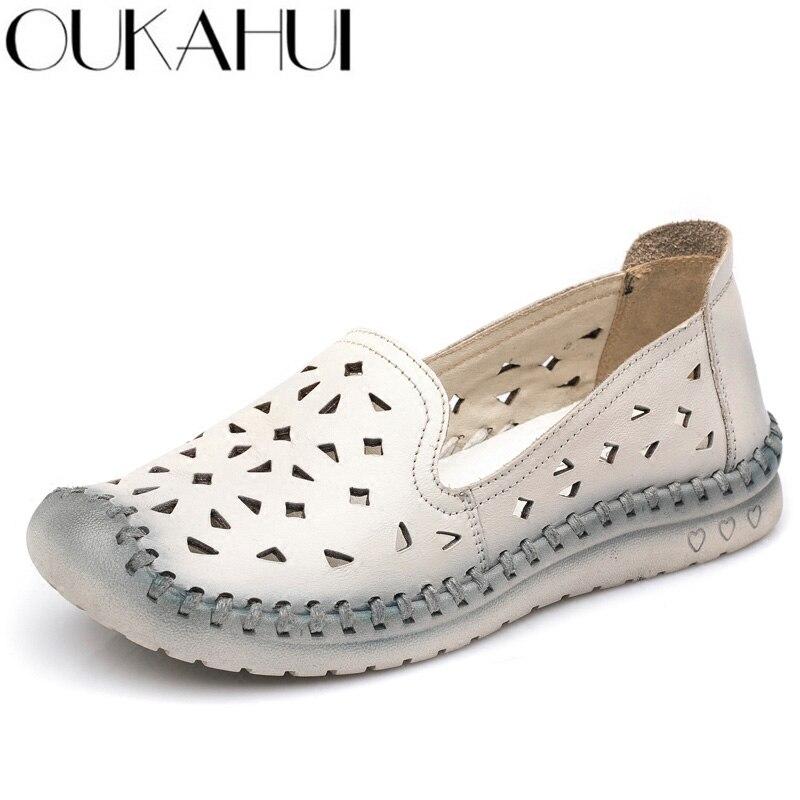 OUKAHUI בעבודת יד אמיתי עור קיץ נעלי נשים דירות רך TPR בלעדי לנשימה חלול החוצה אלגנטי ופרס נעלי נשים 2019