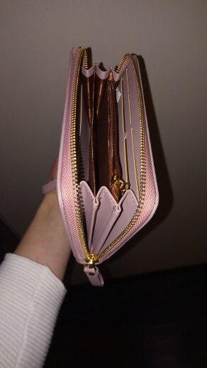 сумочка женщин; держатель кредитной карты ; держатель кредитной карты ; прослушка сотовых телефонов;