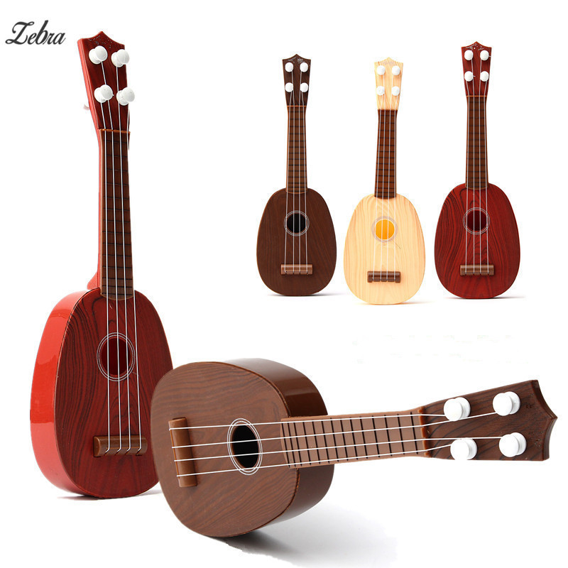 Zebra 4 String Plastic Classical Guitar Ukulele Guitarra Musical Stringed Instrument Toy For Kids Children Play Educational Gift 8pcs meideal capo10 clamp for ukulele and classical guitar