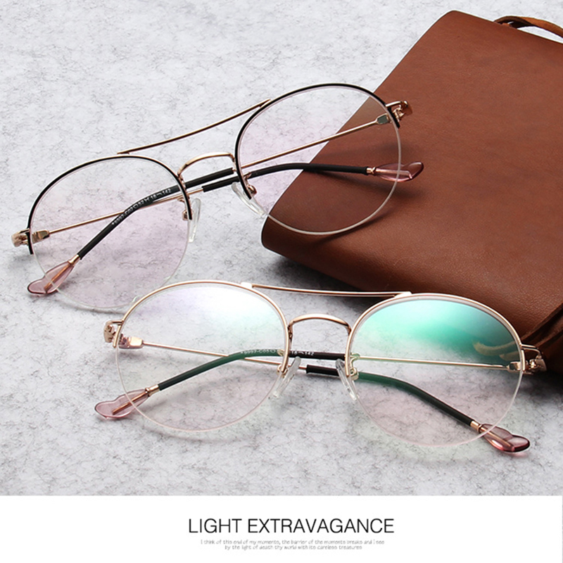 New retro round frame glasses frame fashion metal half frame hanging wire flat mirror comfortable hundred matching glasses.
