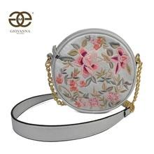 Bolso circular de bandolera para mujer. Con parche de bordado de flores