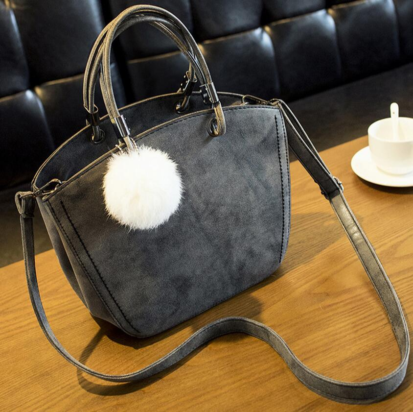 2017 new  handbag with a simple and cute fur ball fashion shoulder bag retro suede bag shoulder  Shell package bag  baobao high tech and fashion electric product shell plastic mold