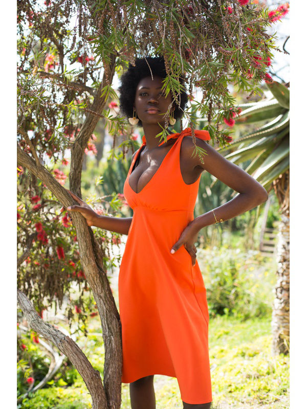 Dress with strings on the shoulders. Color orange.