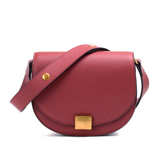 Factory direct Guangzhou leather handbag 2018 new half moon ring slanting saddle bag ladies fashion bag half moon organ type