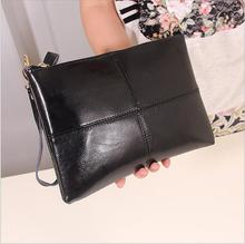 2017 Fashion splicing Women real leather hand carrying bag pochette and female shoulder traveling