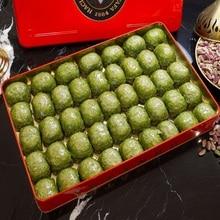 Traditional fresh delicious Turkish Dilber baklava with pistachio. Dessert Baklava Turkish Famous Brand pistachio Baklava