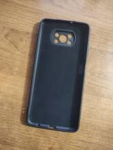 The case is soft silicone color black, the velvet surface inside, the holes are the same,