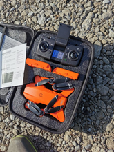 Bottom line up front, this drone is easy to fly, takes great pictures and video, and costs