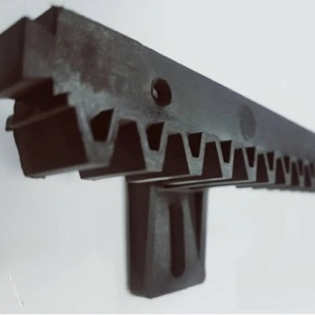 Polymer gear rack for sliding gates with a metal core.