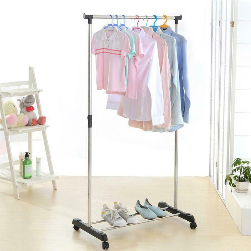 single standing clothes rack floor rack extending and mobile muiltifunctional rack on wheels stainless steel girls standing on lawns