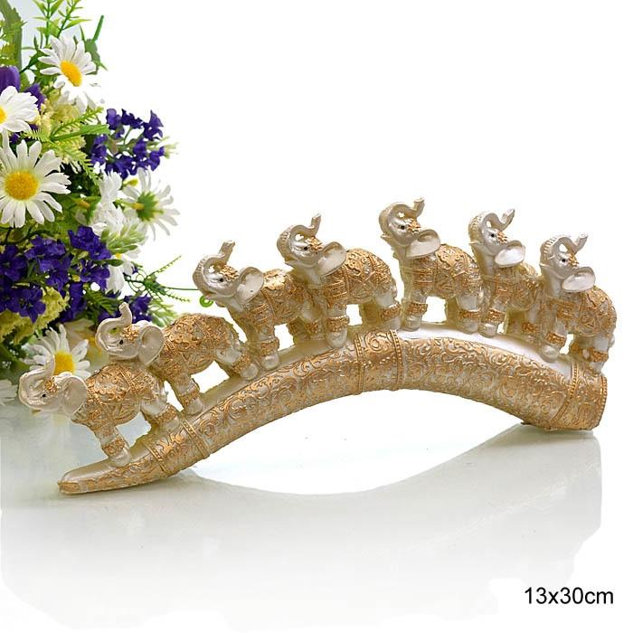 Figurine of elephants on a biade L 30 cm