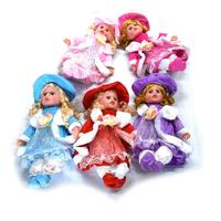 Toy doll in dress and hat length 42 cm, music (3 batteries R44 included)