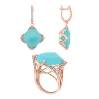 Set jewelry copper under the gold and silver QSY Crown. Women 'S drop earrings with stone. Big Ring with blue zircon