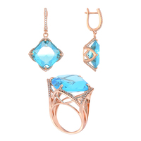 Set jewelry copper under the gold and silver QSY Crown. Women 'S drop earrings with stone. Large ring with blue zircon