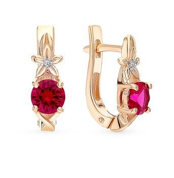 Pendientes de diamantes de rubí dorados con luz solar