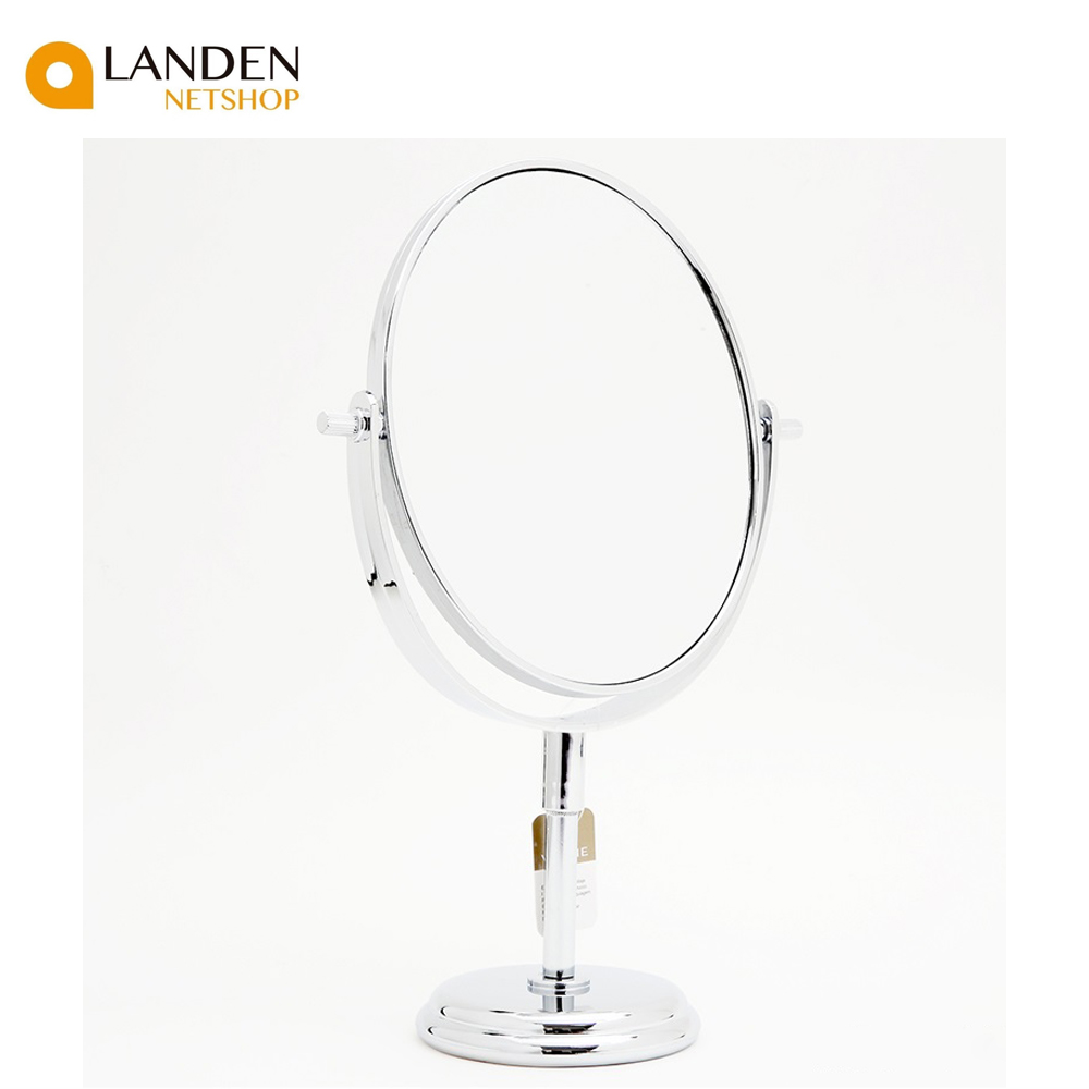 An Oval Mirror Single Vanity With Two Sided, One 2X Magnifying, Other Normal,