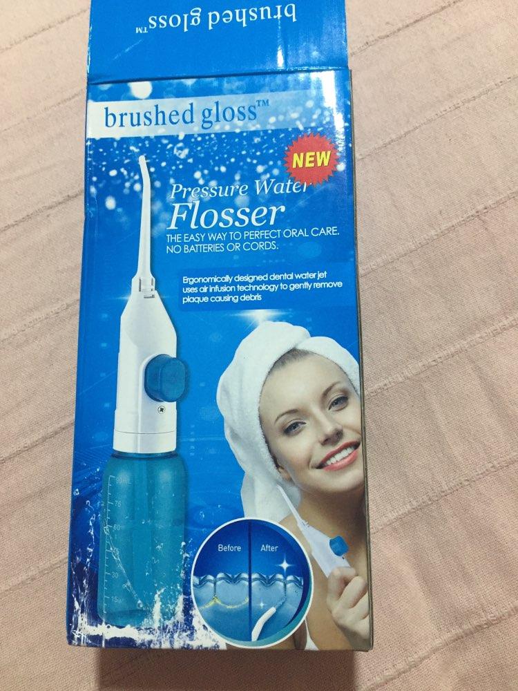 Jato de água irrigador dental CleanTooth Flosser Profissional 100% Original photo review
