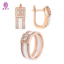Ювелирный набор QSY. Серьги и кольцо из белой и черной керамики с фианитовыми вставками. Бижутерия из меди под золото и серебро.