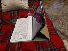 A good cover, dense, the keyboard immediately connected, everything works. As a gift, they