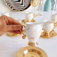 طقم فنجان قهوة بورسلين ذهبي طقم شاي وصلصة 6 قطعة فنجان قهوة تركي رائع النمط الإنجليزي طقم شاي بعد الظهر هدية البيت